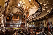 The abandoned Woodward Presbyterian Church, also known as St. Curvy's for its radial balconies, located in Detroit, Michigan.