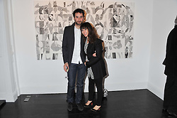 Artist ANNIE MORRIS and her husband IDRIS KHAN at a private view of art works by Annie Morris entitled 'There is A Land Called Loss' held at Pertwee Anderson & Gold Gallery, 15 Bateman Street, London W1 on 2nd February 2012.