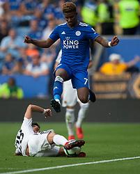 Joao Moutinho of Wolverhampton Wanderers tackles Demarai Gray of Leicester City (R) - Mandatory by-line: Jack Phillips/JMP - 18/08/2018 - FOOTBALL - King Power Stadium - Leicester, England - Leicester City v Wolverhampton Wanderers - English Premier League
