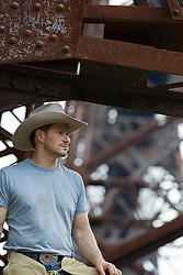 handsome cowboy on an old railroad trestle