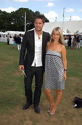 JAMIE & LOUISE REDNAPP at the Cartier International polo at Guards Polo Club, Windsor Great Park, on 30th July 2006.<br />