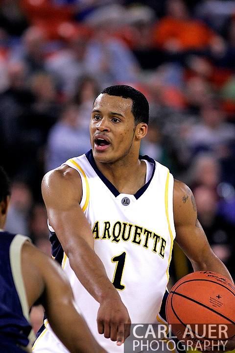 25 November 2005: Marquette Golden Eagle Dominic James (1), a freshman guard, calls for a pick to be set in the Marquette University 73-70 victory over Oral Roberts University at the Great Alaska Shootout in Anchorage, Alaska