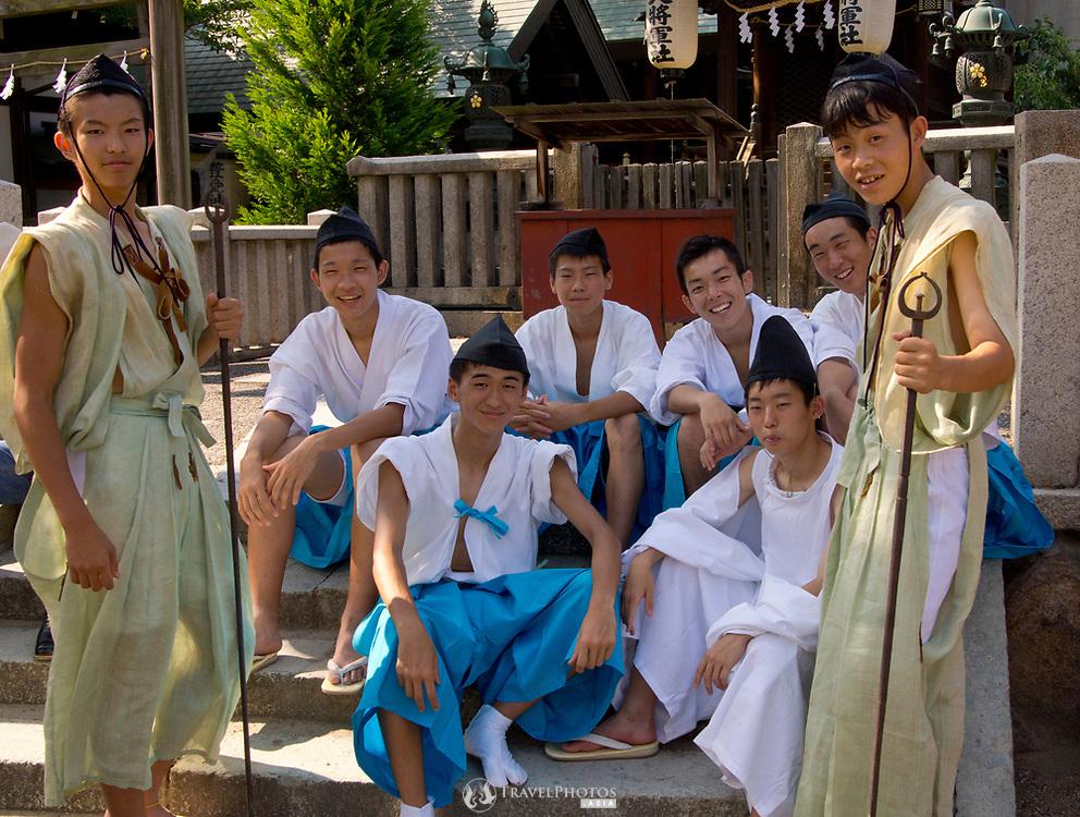 Teenage boys preparing ahead of the Tenjin Festival (Tenjin Matsuri) in Osaka.