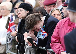 A member of the public mourns as the Funeral procession of former British Prime Minister Margaret Thatcher passes by the High Court in central London, UK, Wednesday 17 April, 2013, Photo by: Julian Andrews / i-Images