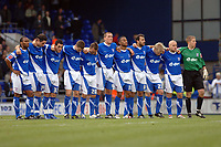 Photo: Ashley Pickering.<br />Ipswich Town v Sheffield Wednesday. Coca Cola Championship. 11/11/2006.<br />Ipswich line up for a minutes silence at the start of the match