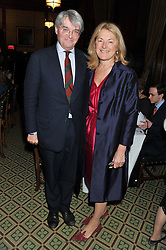 ANDREW MITCHELL MP and his wife SHARON MITCHELL at a gala dinner in aid of Nyumbani the Hot Courses Foundation held in The Members Dining Room,  The House of Commons, London on  7th March 2013.