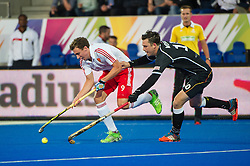 England's Harry Martin is rackled  by Chris Wesley of Germany. England v Germany - Semi-Final Unibet EuroHockey Championships, Lee Valley Hockey & Tennis Centre, London, UK on 27 August 2015. Photo: Simon Parker