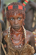 Africa, Ethiopia, Omo River Valley, young Woman of the Hamer Tribe The hair is coated with ochre mud and animal fat