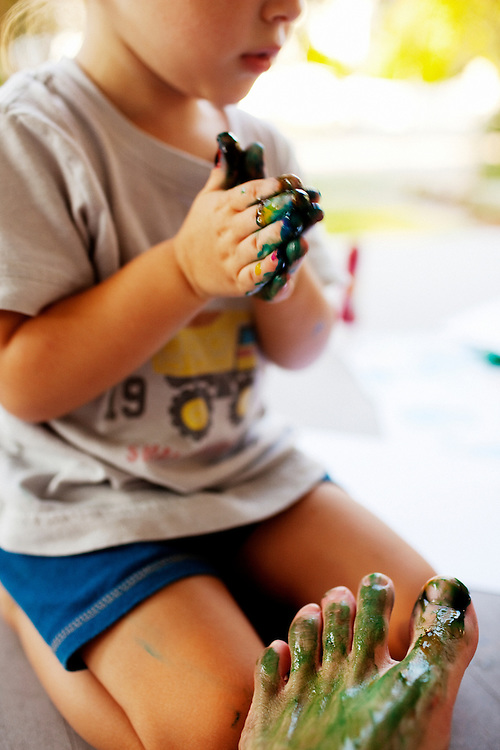 Madelyn Avery Eich, 2, finger paints her father Matt's foot on the front porch of their home in Norfolk, Virginia on Monday, July 26, 2010.