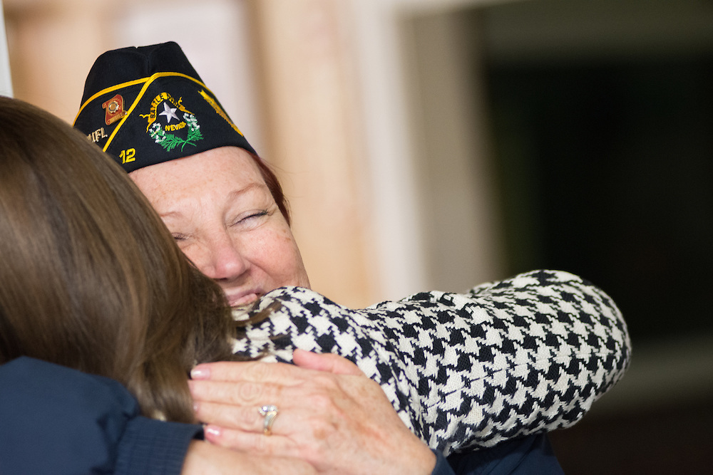 Former American Legion National Vice Commander Jeanette Rae greets Tracy Soliday, a representative of Congressman Mark Amodei (R-Nev.) at American Legion Post 1 in Reno, Nev. before a System Worth Saving town hall on Tuesday, March 8, 2016. Photo by David Calvert /The American Legion.
