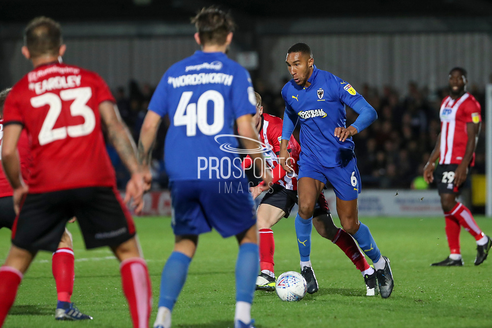 AFC Wimbledon defender Terell Thomas (6) dribbling during the EFL Sky Bet League 1 match between AFC Wimbledon and Lincoln City at the Cherry Red Records Stadium, Kingston, England on 2 November 2019.