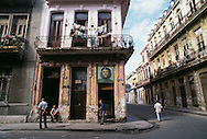 Cuba, Old Havana street showing decay of buildings, mural of Che Guevara