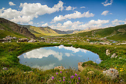 A fresh water spring gurgles up into a round reflection pool below the dam of Kol Suu, a natural lake in the Tien Shan Mountains of the Kyrgyz Republic near the border with China.