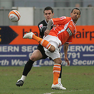 Blackpool - Saturday March 7th, 2009: DJ Cambell of Blackpool and Jason Shackell of Norwich City in action during the Coca Cola Championship match at Bloomfield Road, Blackpool. (Pic by Michael Sedgwick/Focus Images)