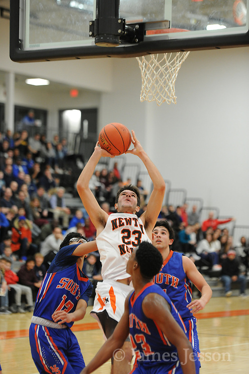 Newton North senior Christian Negrotti brings the ball to the basket during the game against Newton South at Newton North, Dec. 27, 2018.   [Wicked Local Photo/James Jesson]