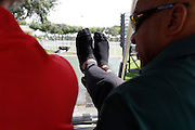 Monday, July 8, 2013 REGGIE WILLIAMS : Former Cincinnati Bengals player and Cincinnati City Councilman Reggie Williams takes off his shoes whenever he's at rest. It helps in his pain management with having one leg longer then the other. He is escorted around his old stomping grounds at the ESPN Wide World of Sports Complex on the Walt Disney property. He helped build the complex from the ground up and was one of Disney's first African American executives.  The Enquirer/Jeff Swinger