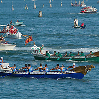 VENICE, ITALY - JUNE 12:  Amalfi racing agaist Venice in the final phases of the Regatta of the Ancient Maritime Republics on June 12, 2011 in Venice, Italy. The idea of the Regatta of the Ancient Maritime Republics was realized in 1955 and the first edition took place in Genova.