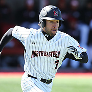 Shane Allen #7 of the Northeastern Huskies runs down the line during the game at Friedman Diamond on March 16, 2014 in Brookline, Massachusetts. (Photo by Elan Kawesch)
