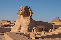 View of the Sphinx and other pyramids and ruins at Giza, Egypt.