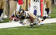 ST. LOUIS - SEPTEMBER 23:  Running back Steven Jackson #39 of the St. Louis Rams dives for yardage and rushes for 97 yards and 2 touchdowns while trying to avoid a tackle by safety Steve Gleason #37 of the New Orleans Saints at the Edward Jones Dome on September 23, 2005 in St. Louis, Missouri. The Rams defeated the Saints 28-17. ©Paul Anthony Spinelli *** Local Caption *** Steven Jackson;Steve Gleason