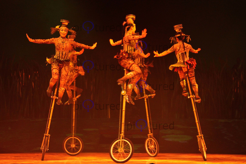 Cirque Du Soleil Totem Unicycles and Bowls Royal Albert Hall, London, UK, 04 January 2011:  Contact: Ian@Piqtured.com +44(0)791 626 2580 (Picture by Richard Goldschmidt)