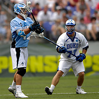 28 May 2007: Johns Hopkins midfielder Stephen Peyser (12) makes a pass in action against Duke University defenseman Nick O'Hara (77) in the NCAA Division I Lacrosse Championship game.  The Johns Hopkins Blue Jays defeated the Duke Blue Devils 12-11 to win the NCAA Division I Lacrosse championship at M&T Bank Stadium in Baltimore, Md. .