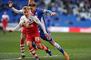 Charlton Athletic 's Chris Solly (l) holds off Cardiff city's Conor McAleny. Skybet football league championship match, Cardiff city v Charlton Athletic at the Cardiff city Stadium in Cardiff, South Wales on Saturday 7th March 2015.<br /> pic by Andrew Orchard, Andrew Orchard sports photography.