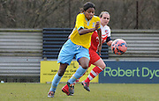 Two goal hero Rochelle Shakes chasing down the loose ball during the Women's FA Cup match between Charlton Athletic WFC and Crystal Palace LFC at Sporting Club Thamesmead, Thamesmead, United Kingdom on 8 March 2015. Photo by Michael Hulf.