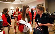 Tara Albrecht (L) Executive Team Leader Human Resources talks with job candidate Briana McShane at a job fair in Golden, Colorado June 7, 2016. REUTERS/Rick Wilking