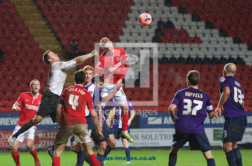 Picture by Alan Stanford/Focus Images Ltd +44 7915 056117<br /> 14/01/2014<br /> Joe Pigott of Charlton Athletic tries to get a late winner but goalkeeper Ryan Clarke of Oxford United punches the ball clear during the The FA Cup match at The Valley, London.