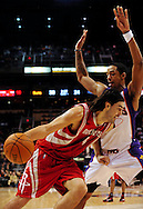 Jan. 6 2010; Phoenix, AZ, USA;  Houston Rockets forward Luis Scola (4) drives to the basket under pressure of   Phoenix Suns at the US Airways Center. Phoenix Suns defeated the Houston Rockets 118-110. Mandatory Credit: Jennifer Stewart-US PRESSWIRE