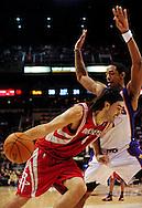 Jan. 6 2010; Phoenix, AZ, USA;  Houston Rockets forward Luis Scola (4) drives to the basket under pressure of   Phoenix Suns at the US Airways Center. Phoenix Suns defeated the Houston Rockets 118-110. Mandatory Credit: Jennifer Stewart-US PRESSWIRE