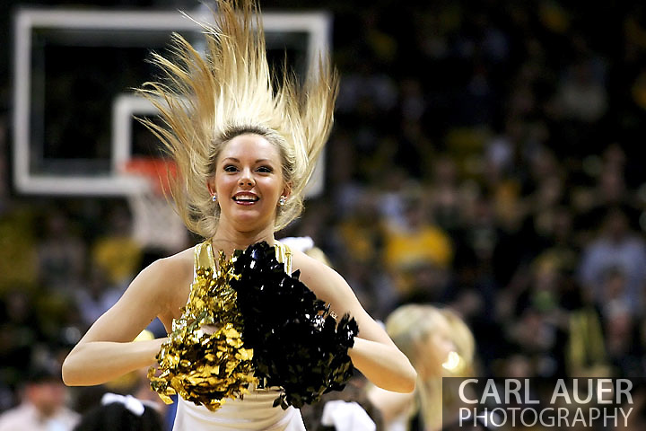 January 27th, 2013 Boulder, CO - A Colorado cheerleader does her best Flashdance hair throw during a time out in the NCAA basketball game between the California Golden Bears and the University of Colorado Buffaloes at the Coors Events Center in Boulder CO