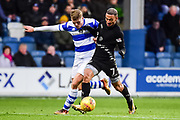 Leeds United striker Kemar Roofe (7) battles for possession with QPR defender Jake Bidwell (3) during the EFL Sky Bet Championship match between Queens Park Rangers and Leeds United at the Loftus Road Stadium, London, England on 9 December 2017. Photo by Dennis Goodwin.