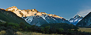 Sunrise brightens Mount Sefton (left) and Aoraki / Mount Cook (right) in Aoraki / Mount Cook National Park, South Island, New Zealand. In 1990, UNESCO honored Te Wahipounamu - South West New Zealand as a World Heritage Area. Panorama stitched from 3 overlapping photos.