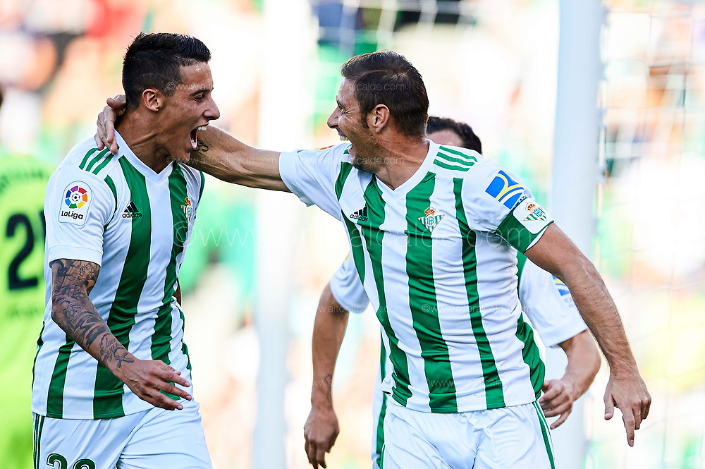 SEVILLE, SPAIN - SEPTEMBER 16:  Joaquin Sanchez of Real Betis Balompie (R) celebrates after scoring with Cristian Tello of Real Betis Balompie (L) during the La Liga match between Real Betis and Deportivo La Coruna at  Estadio Benito Villamarin on September 16, 2017 in Seville, .  (Photo by Aitor Alcalde Colomer/Getty Images)