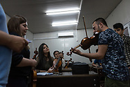 Iraqi Christians learn the violin at Mart Shmoni church, a Syriac Catholic church in Ankawa, a suburb of Erbil, Iraq. Most of the parishioners are IDPs, pushed out of their homes in Qaraqosh during the 2014 ISIS advance. (May 15, 2017)