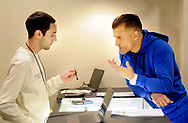 Josh Reiss (left) shows patient Robert Consulmagno a vape pen at TerraVida Holistic Center, which is one of the first medical marijuana dispensary's in Pennsylvania to open Saturday, February 17, 2018 in Sellersville, Pennsylvania. (WILLIAM THOMAS CAIN / For The Inquirer)
