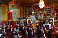 Monks and nuns gather to hear Akong Rinpoche, Tibetan-born founder of the Buddhist monastery at Samye Ling in Dumfriesshire, Scotland, bestows a blessing on his brother Lama Yeshe Losal (dressed in yellow), at a ceremony to mark the latter's 60th birthday.