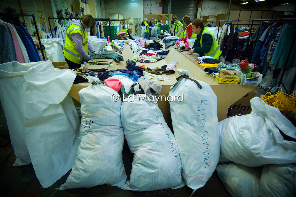 Bags of clothing being sorted to be re-sold or re-cycled at the Salvation Army Trading Company, Wellingborough, Northamptonshire, England, UK.