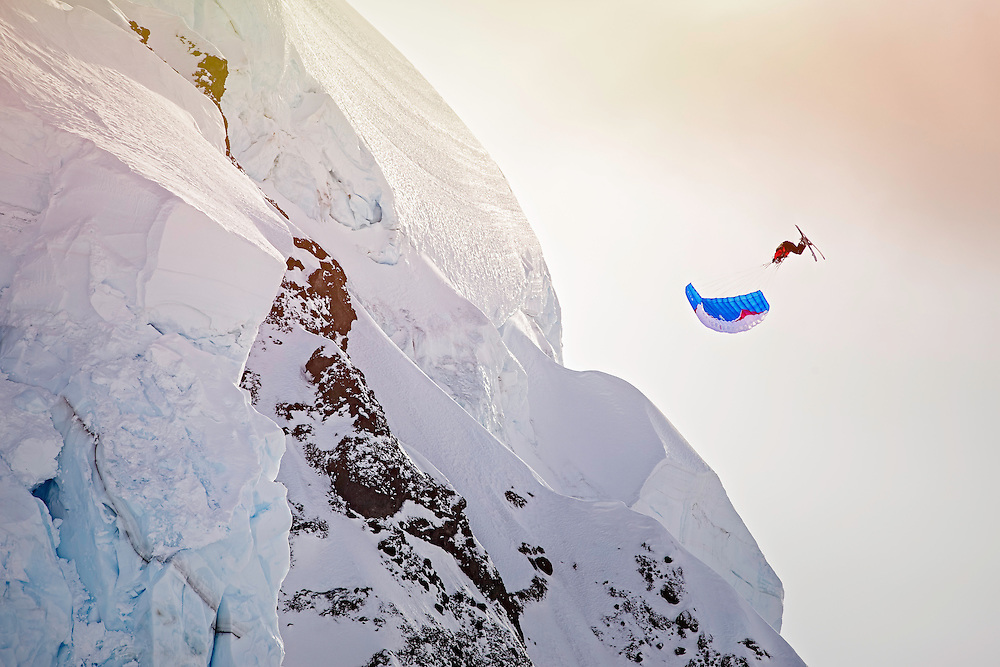 Filippo Fabbi jumps off a large cliff into a spiraling barrel roll while filming for the Unrideables in the Tordrillo Mountains near Anchorage, Alaska on April 29th, 2014.