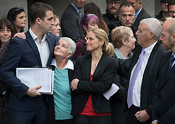 © Licensed to London News Pictures. 23/11/2016. London, UK. Family of murdered MP Jo Cox speak to reporters outside The Old Bailey after Thomas Mair was found guilty of her murder. Jo Cox's husband Brendan Cox (3L),  parents Gordon and Jean Leadbeater,  Jo's sister Kim. Defendant Thomas Mair chose not to give any evidence in his defence.  Mair shot and stabbed the 41-year-old Member of Parliament outside her constituency surgery in Birstall, near Leeds, Yorkshire on June 16 this year and has been given a whole life sentence. Photo credit: Peter Macdiarmid/LNP