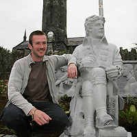 Shane Gilmore sits beside his statue of poet Brian Merriman which was placed outside Teach Ceoil in Ennistymon on Wednesday evening.<br /> <br /> Photograph by Yvonne Vaughan.