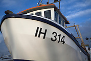 Fishing boat hull in boatyard. Small fishing and sailing hamlet of Felixstowe Ferry at the mouth of the River Deben, Suffolk, England
