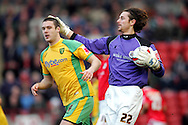 London - Saturday, January 12th, 2008: Heinz Muller of Barnsley and Jason Shackell of Norwich City during the Coca Cola Champrionship match at Oakwell, Barnsley. (Pic by Paul Hollands/Focus Images)