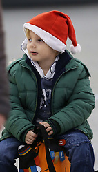 Alex Webster (4) from Bromley, Kent, at the departure lounge of Stansted airport as he prepares to jet off with his family to Majorca, at the start of the Christmas getaway, Friday, 21st December 2012  Photo by: Stephen Lock / i-Images