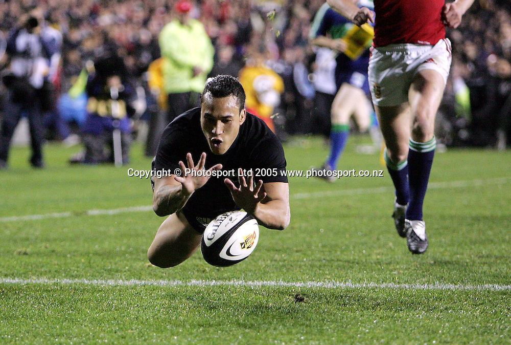 All Black winger Rico Gear dives to score a try during the 3rd test match between the New Zealand All Blacks and the British and Irish Lions at Eden Park in Auckland, New Zealand on Saturday 9 July 2005. The All Blacks defeated the Lions 38-19 to win the 3 test match series 3-0. Photo:Andrew Cornaga/PHOTOSPORT
