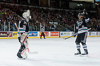 KELOWNA, CANADA - FEBRUARY 16: Cal Foote #25 and Michael Herringer #30 of Kelowna Rockets celebrate a goal against the Red Deer Rebels on February 16, 2016 at Prospera Place in Kelowna, British Columbia, Canada.  (Photo by Marissa Baecker/Shoot the Breeze)  *** Local Caption *** Michael Herringer; Cal Foote;