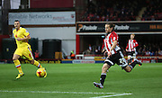 Brentford striker Lasse Vibe driving into the box during the Sky Bet Championship match between Brentford and Milton Keynes Dons at Griffin Park, London, England on 5 December 2015. Photo by Matthew Redman.