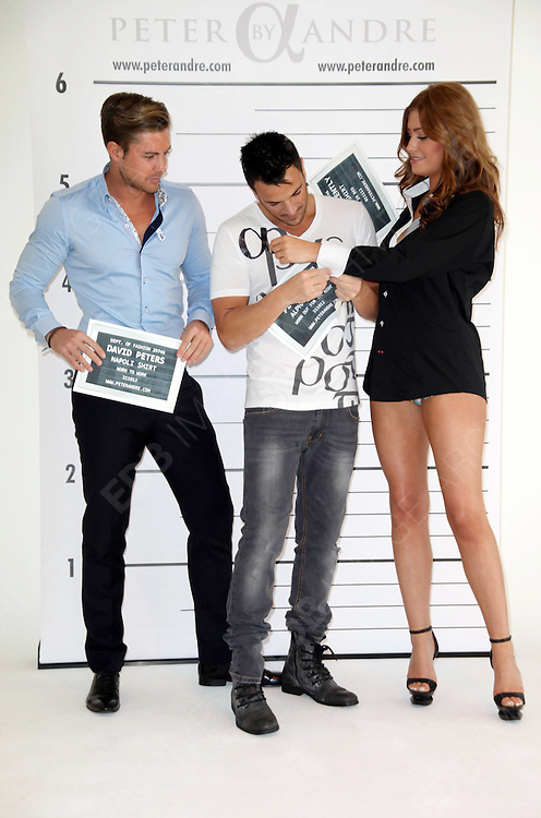 05.NOVEMBER.2012. LONDON<br /> <br /> PETER ANDRE LAUNCHES HIS BRAND NEW AND EXCLUSIVE MENSWEAR COLLECTION &lsquo;PETER ANDRE&rsquo;S ALPHA COLLECTION&rsquo; WHICH INCLUDES ITALIAN MADE TAILORED SHIRTS AND DESIGNER T-SHIRTS, WITH THE HELP OF AMY CHILD'S BOYFRIEND DAVID PETERS AND THE FEMALE MODEL GETS HER SHIRT CAUGHT IN PETER'S HAIR SO HE FIXED IT FOR HER.<br /> <br /> BYLINE: EDBIMAGEARCHIVE.CO.UK<br /> <br /> *THIS IMAGE IS STRICTLY FOR UK NEWSPAPERS AND MAGAZINES ONLY*<br /> *FOR WORLD WIDE SALES AND WEB USE PLEASE CONTACT EDBIMAGEARCHIVE - 0208 954 5968*
